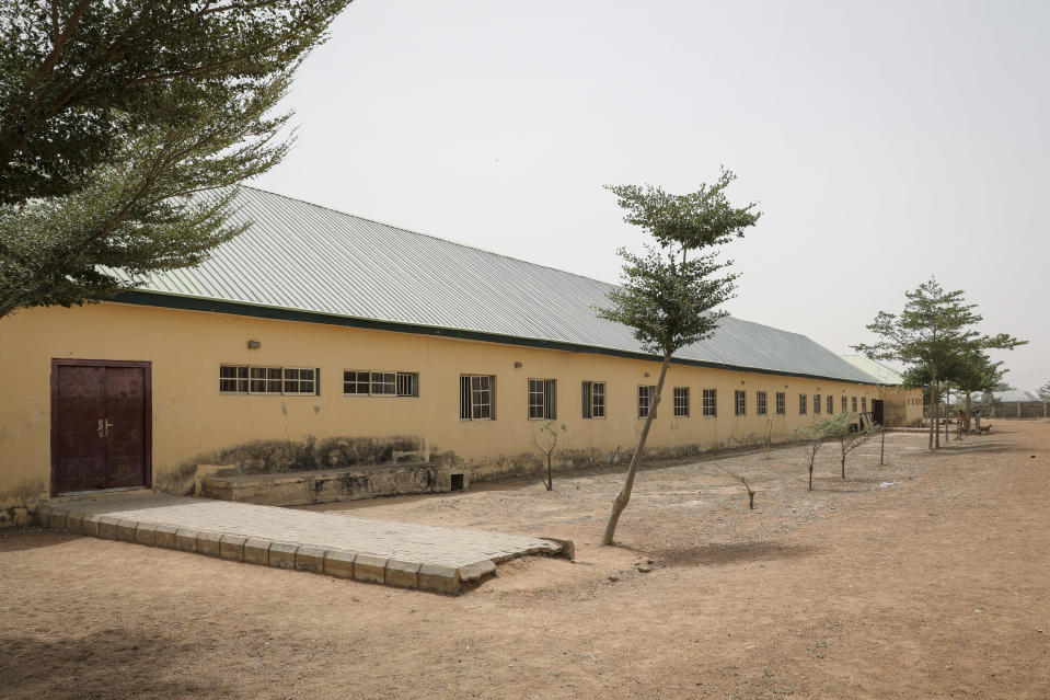 This Saturday, Feb. 27, 2021 photo shows the Government Girls Junior Secondary School from where more than 300 girls were abducted on Friday by gunmen, in Jangebe town, Zamfara state, northern Nigeria. Nigerian police and the military have begun joint operations to rescue the more than 300 girls who were kidnapped from the boarding school, according to a police spokesman. (AP Photo/Ibrahim Mansur)