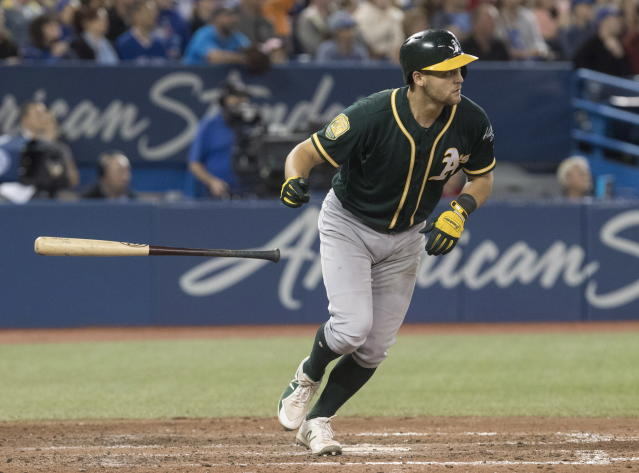 Oakland Athletics' Chad Pinder watches the ball after hitting a grand slam against the Toronto Blue Jays in the eighth inning of a baseball game in Toronto, Saturday, May 19, 2018. (Fred Thornhill/The Canadian Press via AP)