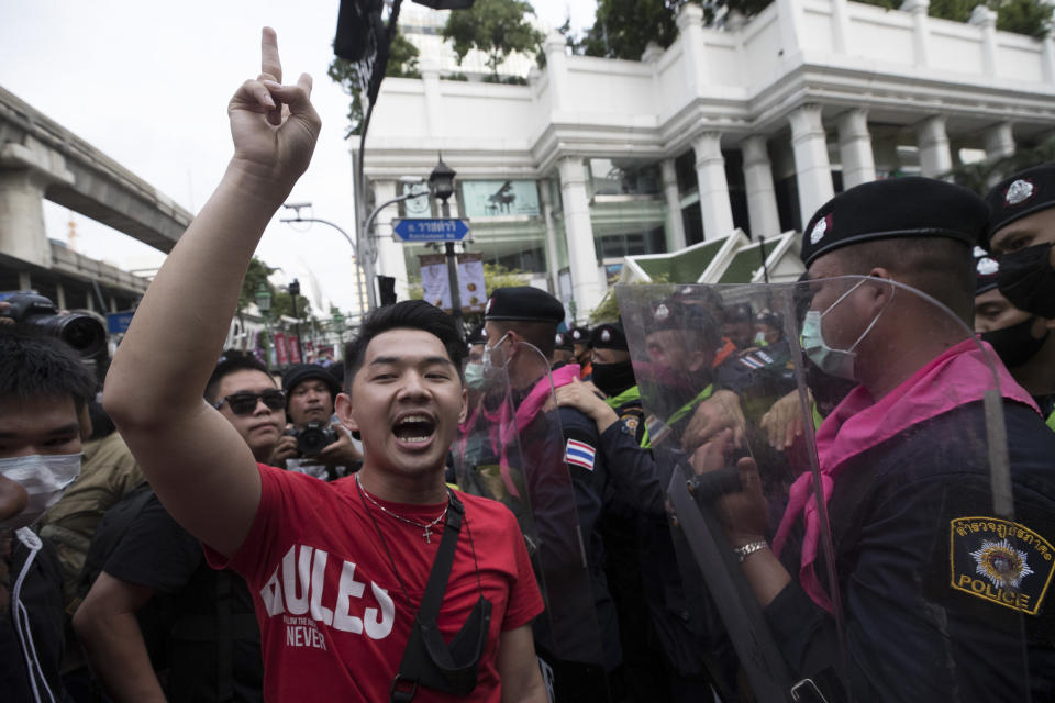 A pro-democracy protester gives a three-finger salute, a symbol of resistance, during a protest as they occupied the main road in the central business district in Bangkok, Thailand, Thursday, Oct. 15, 2020. Thailand's government declared a strict new state of emergency for the capital on Thursday, a day after a student-led protest against the country's traditional establishment saw an extraordinary moment in which demonstrators heckled a royal motorcade. (AP Photo/Wason Wanichakorn)