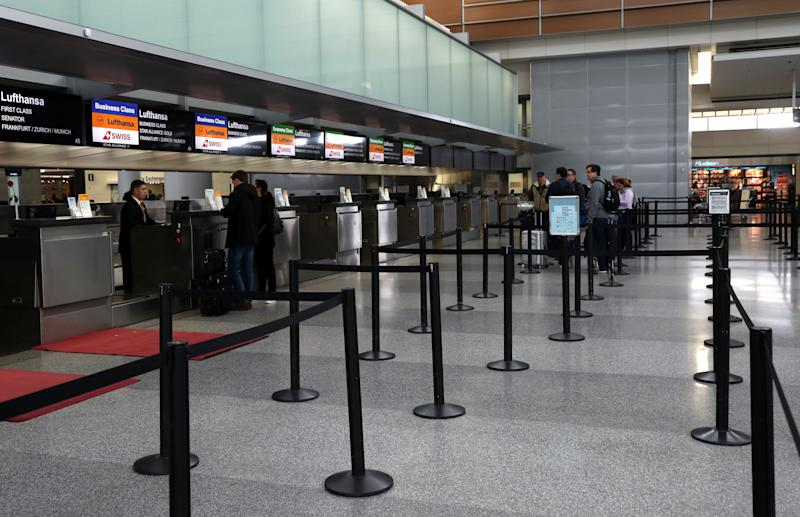 Ticket counters were nearly empty in the international terminal at San Francisco International Airport recently, in the wake of the COVID-19 outbreak. What if you want to cancel, too? (Photo: Justin Sullivan/Getty Images)