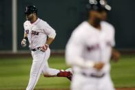 Boston Red Sox's Mitch Moreland rounds the bases on his two-run home run that also drove in Xander Bogaerts, right, during the third inning of a baseball game against the Toronto Blue Jays, Friday, Aug. 7, 2020, in Boston. (AP Photo/Michael Dwyer)