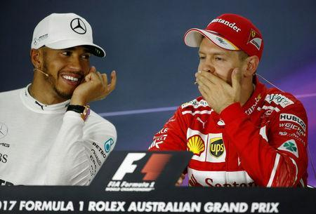 Formula One - F1 - Australian Grand Prix - Melbourne, Australia - 26/03/2017 - Ferrari driver Sebastian Vettel of Germany (R) participates in the post-race press conference alongside second-placed Mercedes driver Lewis Hamilton of Britain. REUTERS/Brandon Malone