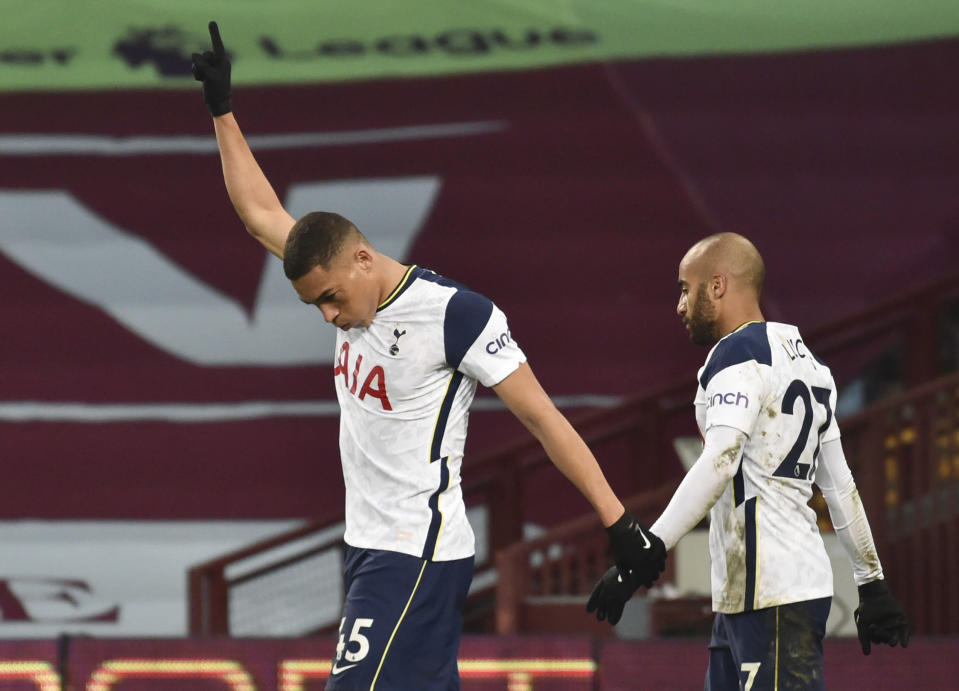 Tottenham's Carlos Vinicius reacts after scoring his team's first goal during the English Premier League soccer match between Aston Villa and Tottenham Hotspur at Villa Park in Birmingham, England, Sunday, March 21, 2021. (AP Photo/Rui Vieira,Pool)