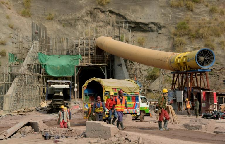 More than 6,000 Pakistani and Chinese workers busy themselves in the 28 kilometres (17 miles) of underground tunnels or in the power station itself, buried under 400 metres of rock in the heart of the Himalayas
