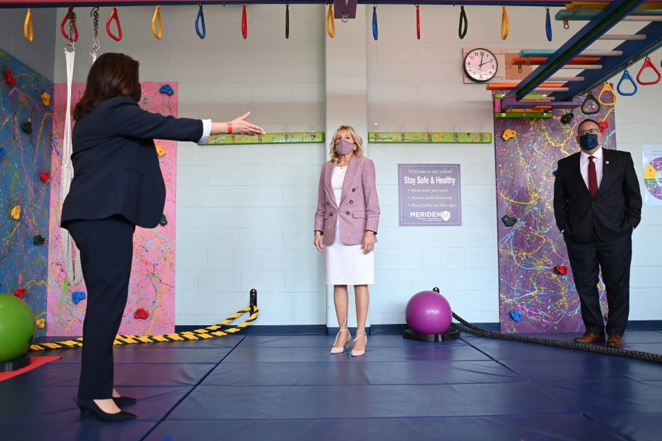 First lady Jill Biden and Education Secretary Miguel Cardona, right, tour Benjamin Franklin Elementary School, Wednesday, March 3, 2021 in Meriden, Ct. (Mandel Ngan/Pool via AP)