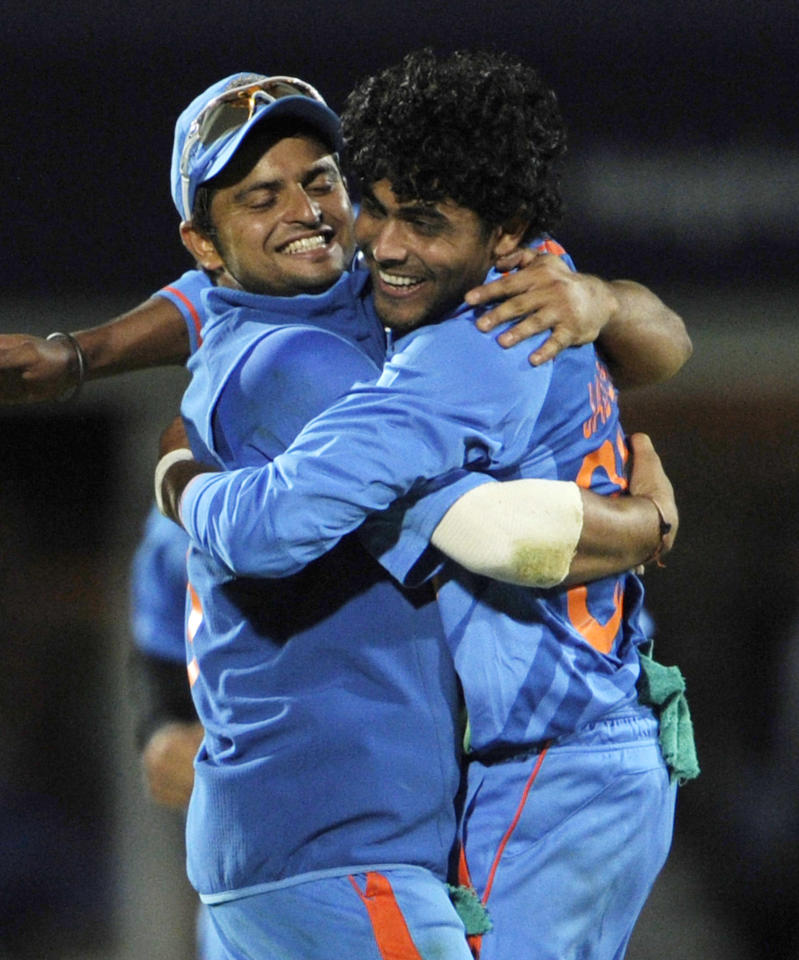 India's Ravindra Jadeja, right, celebrates with Suresh Raina after claiming the wicket of England's Tim Bresnan during their one day international cricket match at the Oval cricket ground, London, Friday Sept. 9, 2011. (AP Photo/Tom Hevezi)