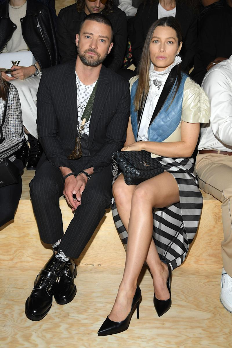 Justin Timberlake (left) sits next to Jessica Biel (right) both with serious expressions