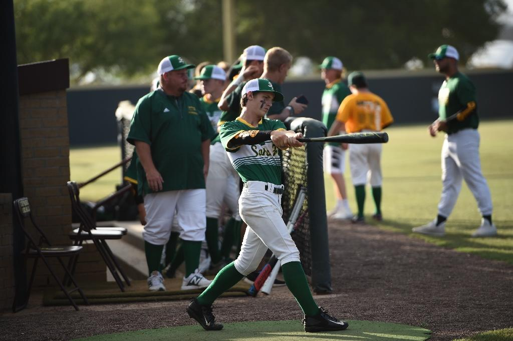 Santa Fe High School baseball team players warm up before a game, just one day after several of their classmates were murdered in a shooting at their Texas school (AFP Photo/Brendan SMIALOWSKI)