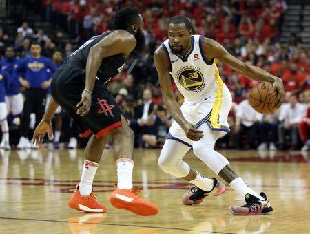 May 16, 2018; Houston, TX, USA; Golden State Warriors forward Kevin Durant (35) moves the ball against Houston Rockets guard James Harden (13) during the second half in game two of the Western conference finals of the 2018 NBA Playoffs at Toyota Center. Mandatory Credit: Thomas B. Shea-USA TODAY Sports