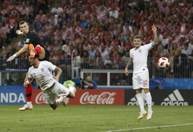Croatia's Ivan Perisic scores his side's opening goal during the semifinal match between Croatia and England at the 2018 soccer World Cup in the Luzhniki Stadium in, Moscow, Russia, Wednesday, July 11, 2018. (AP Photo/Alastair Grant)