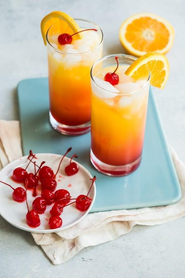 """<p>Rise, shine, and enjoy a tequila sunrise! Mardi Gras fans are all about this fruity libation, and we're here for it.</p> <p><strong>Get the recipe</strong>: <a href=""""https://www.culinaryhill.com/tequila-sunrise-recipe/"""" class=""""link rapid-noclick-resp"""" rel=""""nofollow noopener"""" target=""""_blank"""" data-ylk=""""slk:tequila sunrise"""">tequila sunrise</a></p>"""
