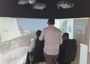 Team using virtual reality to assess the impacts of the new VLocity train design for train drivers.