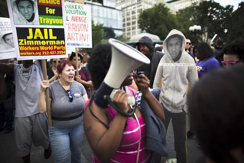Demonstrators march in Union Square Sunday, July 14, 2013, in New York, during a protest against the acquittal of member George Zimmerman in the killing of 17-year-old Trayvon Martin in Florida. Demonstrators upset with the verdict protested mostly peacefully in Florida, Milwaukee, Atlanta and other cities overnight and into Sunday. (AP Photo/John Minchillo)
