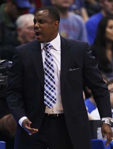 Howard coach Kevin Nickelberry yells to his team during the first half of an NCAA college basketball game against Kansas in Lawrence, Kan., Thursday, Dec. 29, 2011. (AP Photo/Orlin Wagner)