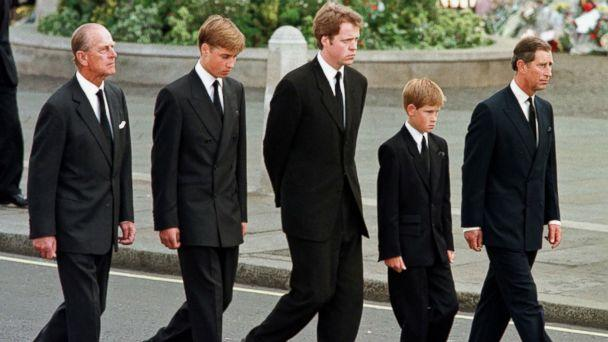 Britain's Prince Philip, Duke of Edinburgh, Prince William, Earl Spencer, Prince Harry and Prince Charles, Prince of Wales walk outside Westminster Abbey during the funeral service for Diana, Princess of Wales in London, Sept. 6, 1997. (jeff J Mitchell/AFP/Getty Images)
