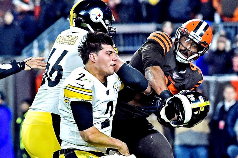 Nov 14, 2019; Cleveland, OH, USA; Cleveland Browns defensive end Myles Garrett (95) hits Pittsburgh Steelers quarterback Mason Rudolph (2) with his own helmet as offensive guard David DeCastro (66) tries to stop Garrett during the fourth quarter at FirstEnergy Stadium. Mandatory Credit: Ken Blaze-USA TODAY Sports TPX IMAGES OF THE DAY