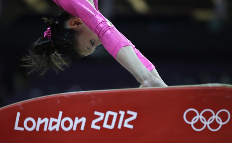 U.S. gymnast Mc Kayla Maroney performs on the vault during training at the 2012 Summer Olympics, Thursday, July 26, 2012, in London. (AP Photo/Julie Jacobson)