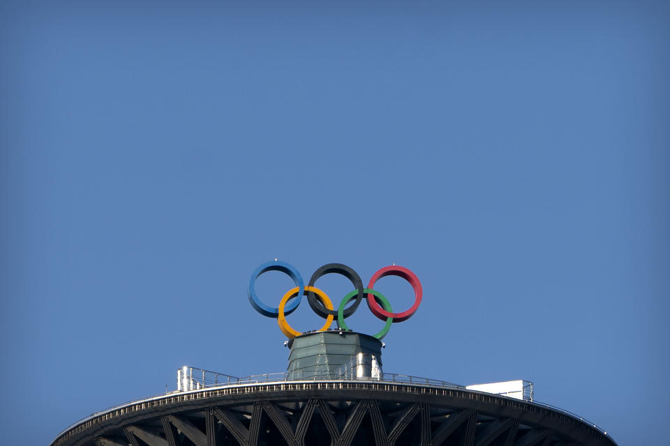 The Olympic rings are visible atop the Olympic Tower in Beijing, Tuesday, Feb. 2, 2021. A small core of international lawyers and activists are prodding leading Olympic sponsors to acknowledge China's widely reported human-rights abuses against Muslim Uyghurs, Tibetans and other minorities. (AP Photo/Mark Schiefelbein)