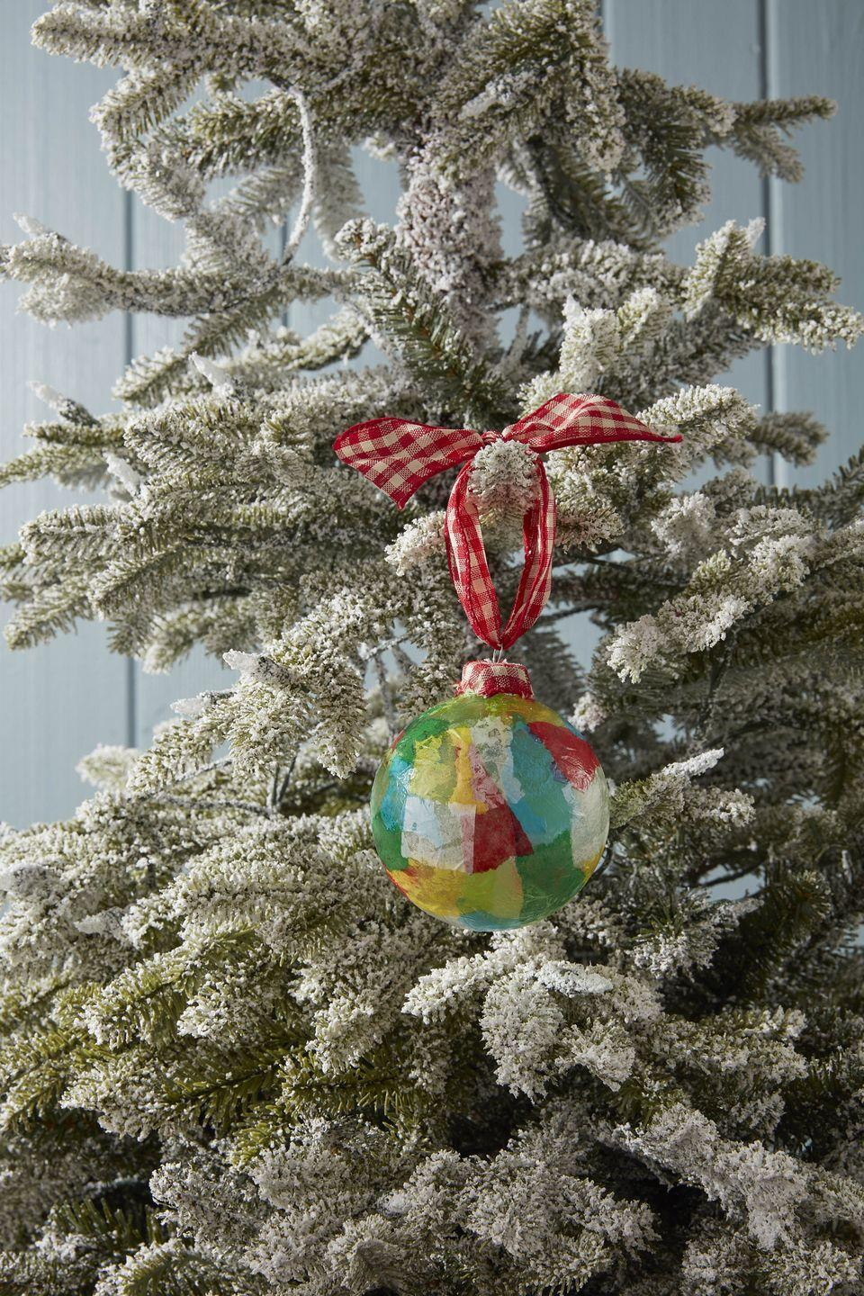 "<p>As simple as tearing and gluing this sweet and colorful ornament will take longer to dry than it does to make.</p><p><strong>To make:</strong> Tear colorful tissue paper into small pieces. Attach to a clear glass or plastic ball ornament with glossy Mod Podge. Attach a small piece of ribbon or fabric over the ornament cap. Hang to dry.</p><p><a class=""link rapid-noclick-resp"" href=""https://www.amazon.com/Darice-2610-42-6-Piece-Heavy-Glass/dp/B002Z1WFVE/ref=sr_1_1_sspa?tag=syn-yahoo-20&ascsubtag=%5Bartid%7C10050.g.1070%5Bsrc%7Cyahoo-us"" rel=""nofollow noopener"" target=""_blank"" data-ylk=""slk:SHOP GLASS ORNAMENTS"">SHOP GLASS ORNAMENTS</a></p>"