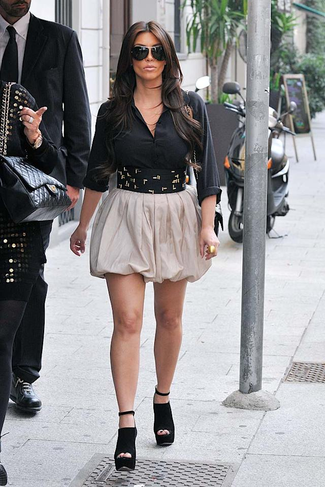 """Kim Kardashian strutted her stuff in a belted bubble skirt and sexy suede footwear while shopping in Milan. <a href=""""http://www.splashnewsonline.com"""" target=""""new"""">Splash News</a> - September 20, 2010"""