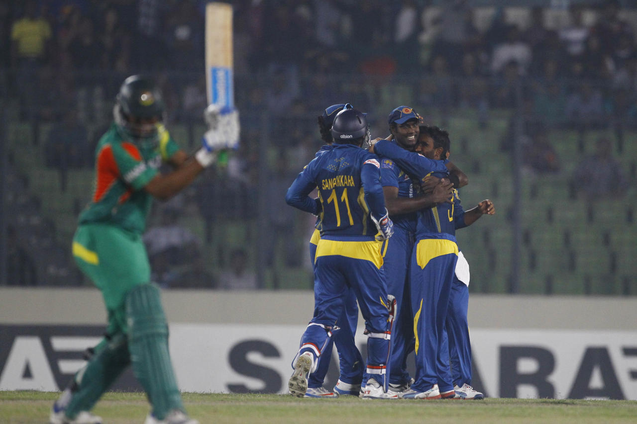 Sri Lanka's Ashan Priyanjan, right, celebrates with teammates the wicket of Bangladesh's Shakib Al Hasan during their second one-day international (ODI) cricket match in Dhaka, Bangladesh, Thursday, Feb. 20, 2014. (AP Photo/A.M. Ahad)