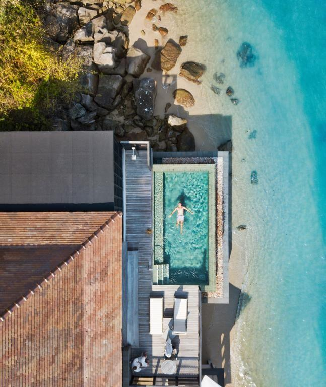 """<p>The Ritz-Carlton Langkawi's Grand Ocean View villa comes complete with it's own pool, deck and private view of the beach. Dreamy.</p><p>Book via: <a href=""""https://www.booking.com/hotel/my/the-ritz-carlton-langkawi.en-gb.html?aid=356980;label=gog235jc-1DCAsooQFCGXRoZS1yaXR6LWNhcmx0b24tbGFuZ2thd2lIM1gDaFCIAQGYAQm4AQfIAQzYAQPoAQGIAgGoAgO4AvG01OcFwAIB;sid=2b6fe282ecd374cd86388d0f81b68b8e;dist=0&keep_landing=1&sb_price_type=total&type=total&"""" rel=""""nofollow noopener"""" target=""""_blank"""" data-ylk=""""slk:Booking.com"""" class=""""link rapid-noclick-resp"""">Booking.com</a></p>"""