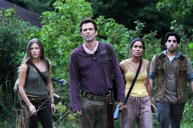 """This image released by NBC shows, from left, Tracy Spiridakos as Charlie Matheson, Billy Burke as Miles Matheson, Daniella Alonso as Nora, and Paras Patel as Albert, in a scene from """"Revolution."""" The series by J.J. Abrams tells of a world 15 years after the world inexplicably suffers a power outage. Every gadget, light source, communications means and motor vehicle is the victim of a seemingly permanent blackout. It airs Mondays at 10 p.m. EDT on NBC. (AP Photo/NBC, Brownie Harris)"""