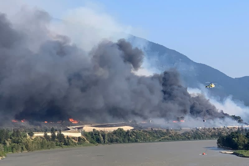 FILE PHOTO: Smoke rises above the small western Canadian town of Lytton after wildfires forced its residents to evacuate