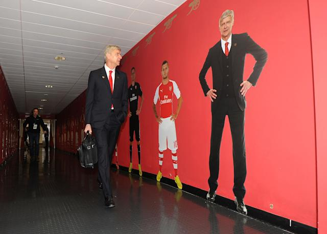 Arsene Wenger walks out of the stadium he practically built. (Getty)