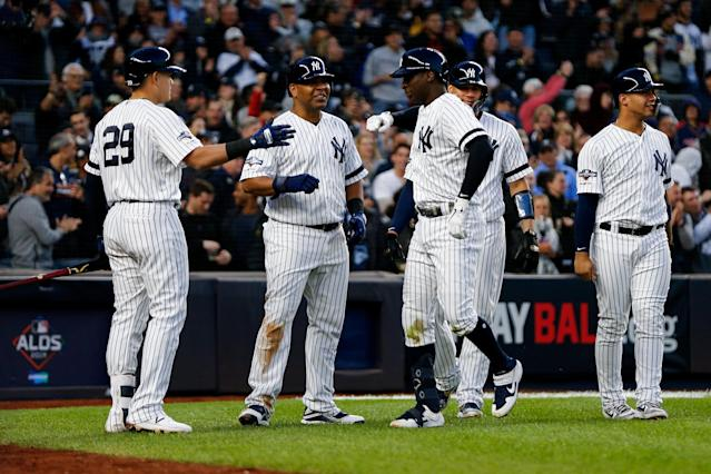 Oct 5, 2019; Bronx, NY, USA; New York Yankees shortstop Didi Gregorius (middle right) celebrates after hitting a grand slam with teammates against the Minnesota Twins in the third inning in game two of the 2019 ALDS playoff baseball series at Yankee Stadium. Mandatory Credit: Andy Marlin-USA TODAY Sports