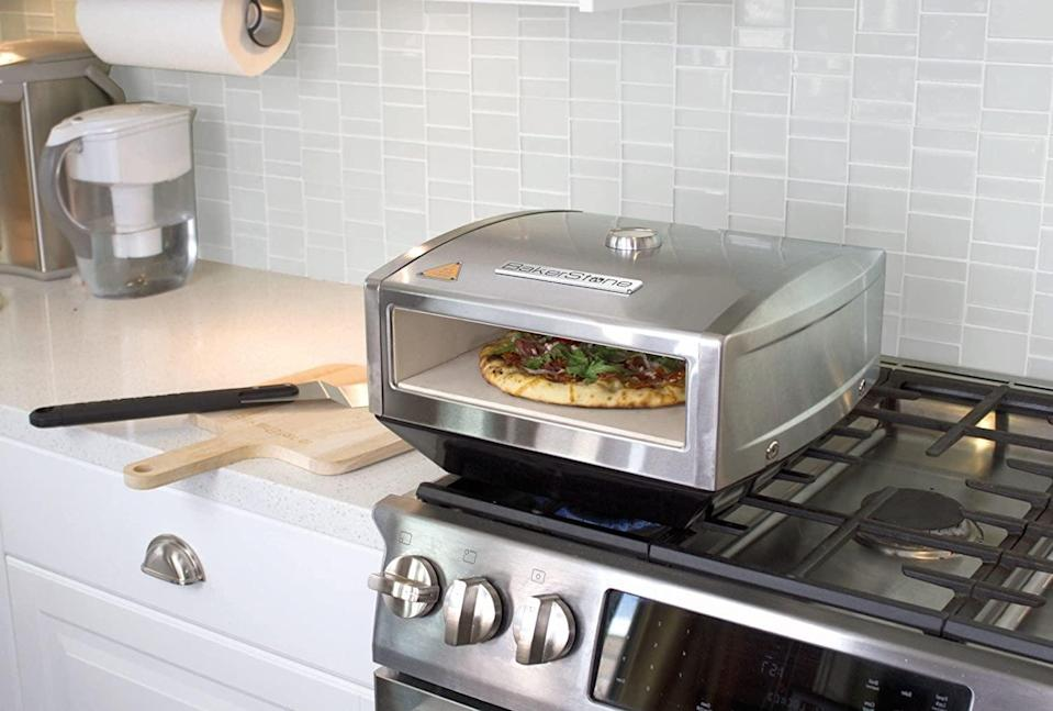 <p>Make the best homemade pizzas with the <span>BakerStone Pizza Box</span> ($148) it's a stainless steel, gas stove top oven that can be used indoors and outdoors.</p>