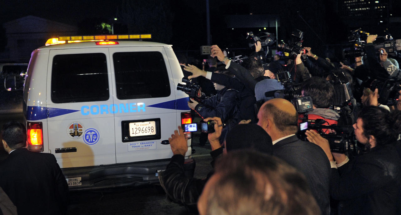 Media mobs a coroner's van as it leaves the Beverly Hilton Hotel, early Sunday, Feb. 12, 2012, in Beverly Hills, Calif. Whitney Houston, who ruled as pop music's queen until her majestic voice and regal image were ravaged by drug use, erratic behavior and a tumultuous marriage to singer Bobby Brown, died Saturday. She was 48. (AP Photo/Mark J. Terrill)
