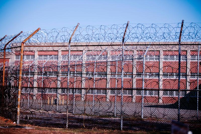Barbed wire fences surround a building on Rikers Island Correctional Facility