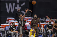 Sacramento Kings guard Buddy Hield (24) hits a three point basket against the Los Angeles Lakers in the second quarter of an NBA basketball game in Sacramento, Calif., Wednesday, March 3, 2021. (AP Photo/Hector Amezcua)