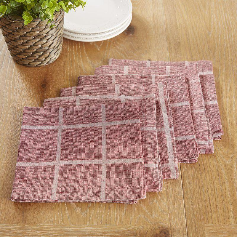 "This weathered <a href=""https://www.wayfair.com/kitchen-tabletop/pdp/birch-lane-jonesport-napkins-bl21810.html?piid%5B0%5D=20106083&piid[0]=20106085&piid=20106085"" target=""_blank"">plaid napkin set</a> gives these everyday napkins a timeless farmhouse feel."