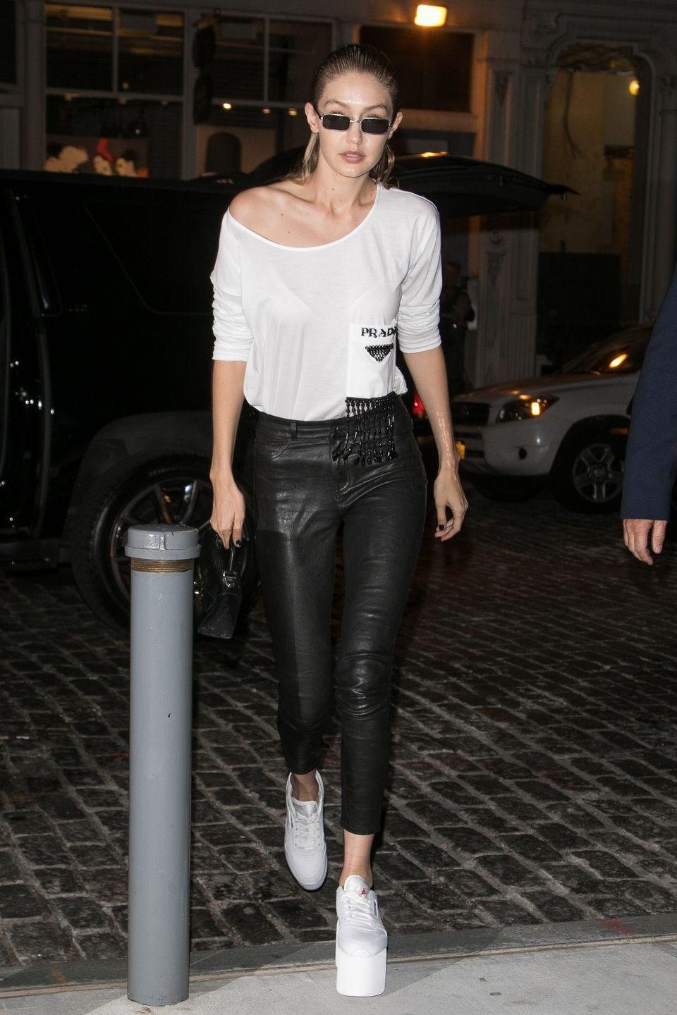 <p>Gigi Hadid has just accomplished the seemingly impossible mission we've all been on since the age of six: finding Baby Spice's sky-high platform sneakers. The model killed the retro look, pairing her statement kicks with a Prada tee and leather skinnies. </p>