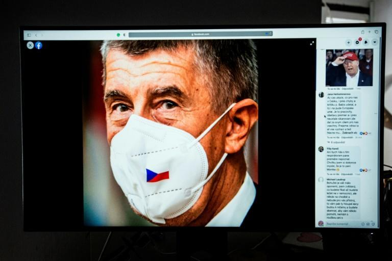 """A computer screen with the new Facebook profile of Czech Prime Minister Andrej Babis wearing a face mask with the Czech flag. Until January 6, Babis had sported a hat saying """"STRONG CZECHIA"""" in his profile picture similar to Trump's MAGA cap."""