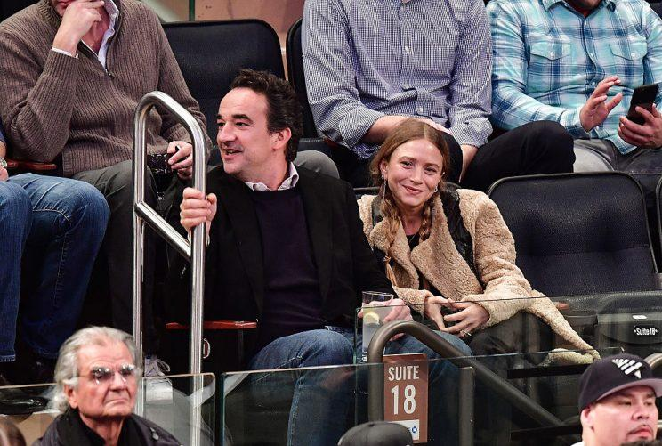 Mary-Kate Olsen and Olivier Sarkozy attend the New York Knicks vs. Brooklyn Nets game at Madison Square Garden on November 9, 2016 in New York City.
