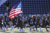 Nevada takes the field to face San Diego State in an NCAA college football game Saturday, Nov. 21, 2020, Reno, Nev. (AP Photo/Lance Iversen)