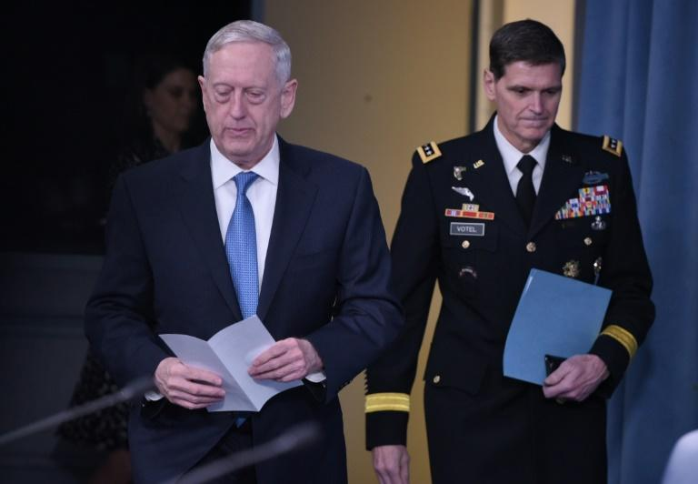 US Secretary of Defense James Mattis (L) and Central Command Commander Joseph Votel arrive for a briefing at the Pentagon in Washington, DC, on April 11, 2017