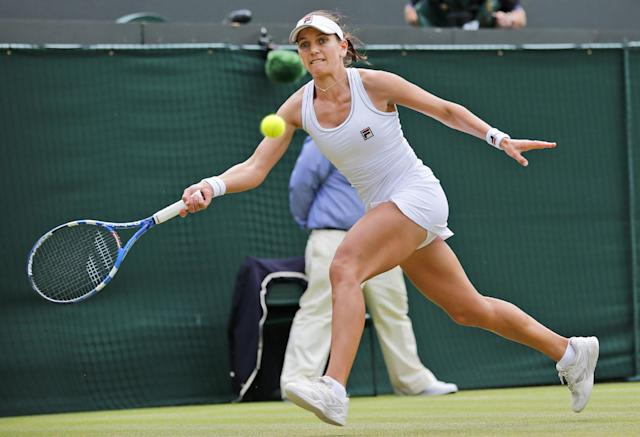 Chanelle Scheepers of South Africa plays a return to Serena Williams of the U.S. during their women's singles match at the All England Lawn Tennis Championships in Wimbledon, London, Thursday, June 26, 2014. (AP Photo/Ben Curtis)