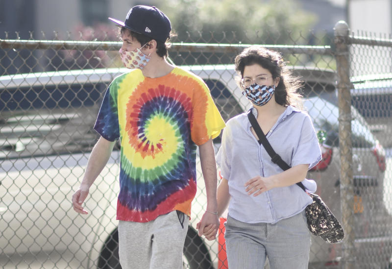 NEW YORK, NEW YORK - MAY 25: A couple is seen wearing a Larry David and a Judge Judy protective mask during the coronavirus pandemic on May 25, 2020 in Brooklyn, New York. (Photo by Daniel Zuchnik/Getty Images)