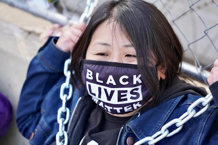 high school English teacher Kaia Hirt, 48, sat wrapped in blankets and heavy chains locked to the security fence surrounding the Hennepin County Government Center on March 30, 2021. Tuesday afternoon, she was one of only about 10 people quietly calling for justice for Floyd.