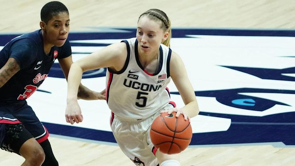 Paige Bueckers drives to the basket against St. John's