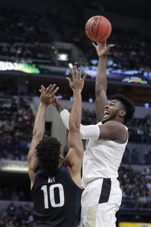 Purdue's Trevion Williams (50) shoots over Butler's Bryce Nze (10) during the first half of an NCAA college basketball game, Saturday, Dec. 21, 2019 in Indianapolis. (AP Photo/Darron Cummings)