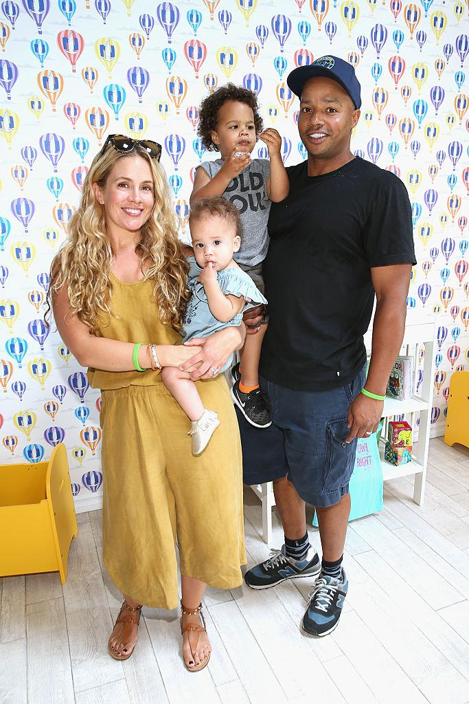 CULVER CITY, CA - APRIL 24: Actor Donald Faison (R), CaCee Cobb (L) and children attend Safe Kids Day at Smashbox Studios on April 24, 2016 in Culver City, California. (Photo by Jonathan Leibson/Getty Images for Safe Kids Worldwide)