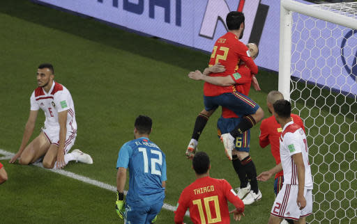 Spain's Isco (22) celebrates after scoring his side's first goal during the group B match between Spain and Morocco at the 2018 soccer World Cup in the Kaliningrad Stadium in Kaliningrad, Russia, Monday, June 25, 2018. (AP Photo/Michael Sohn)