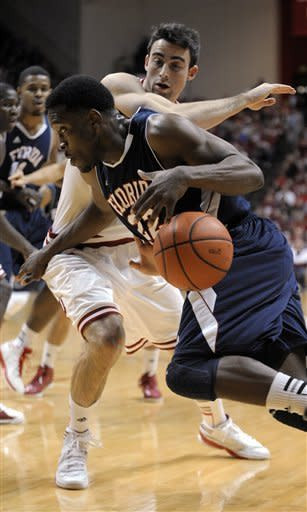 Indiana's Will Sheehey guards as Florida Atlantic's Greg Gantt drives to the basket during the first half of an NCAA college basketball game in Bloomington, Ind., Friday, Dec. 21, 2012. (AP Photo Alan Petersime)