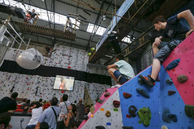 Members of a climbing gym watch as France and Switzerland play during their 2014 World Cup Group E soccer match, during a live telecast of the match on a giant screen in Lyon June 20, 2014. REUTERS/Robert Pratta (FRANCE - Tags: SOCCER SPORT WORLD CUP)