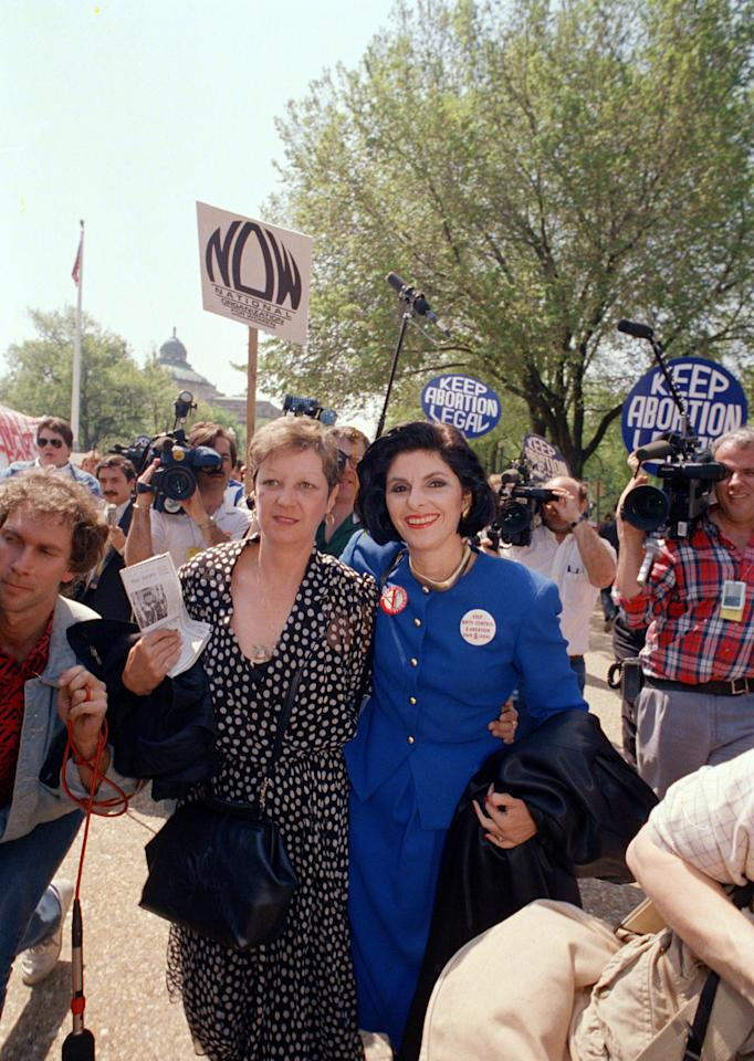 Jane Roe, left, a Texas cleaning woman whose pregnancy led to the 1973 landmark decision legalizing abortion, walks with her attorney Gloria Allred outside the Supreme Court Wednesday, April 27, 1989 in Washington. Roe, whose real name is Norma McCorvey, observed the high court as it heard arguments in Missouri case which could overturn the Roe vs. Wade decision. (AP Photo/J.Scott Applewhite)